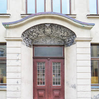 Alesund door with owl motif