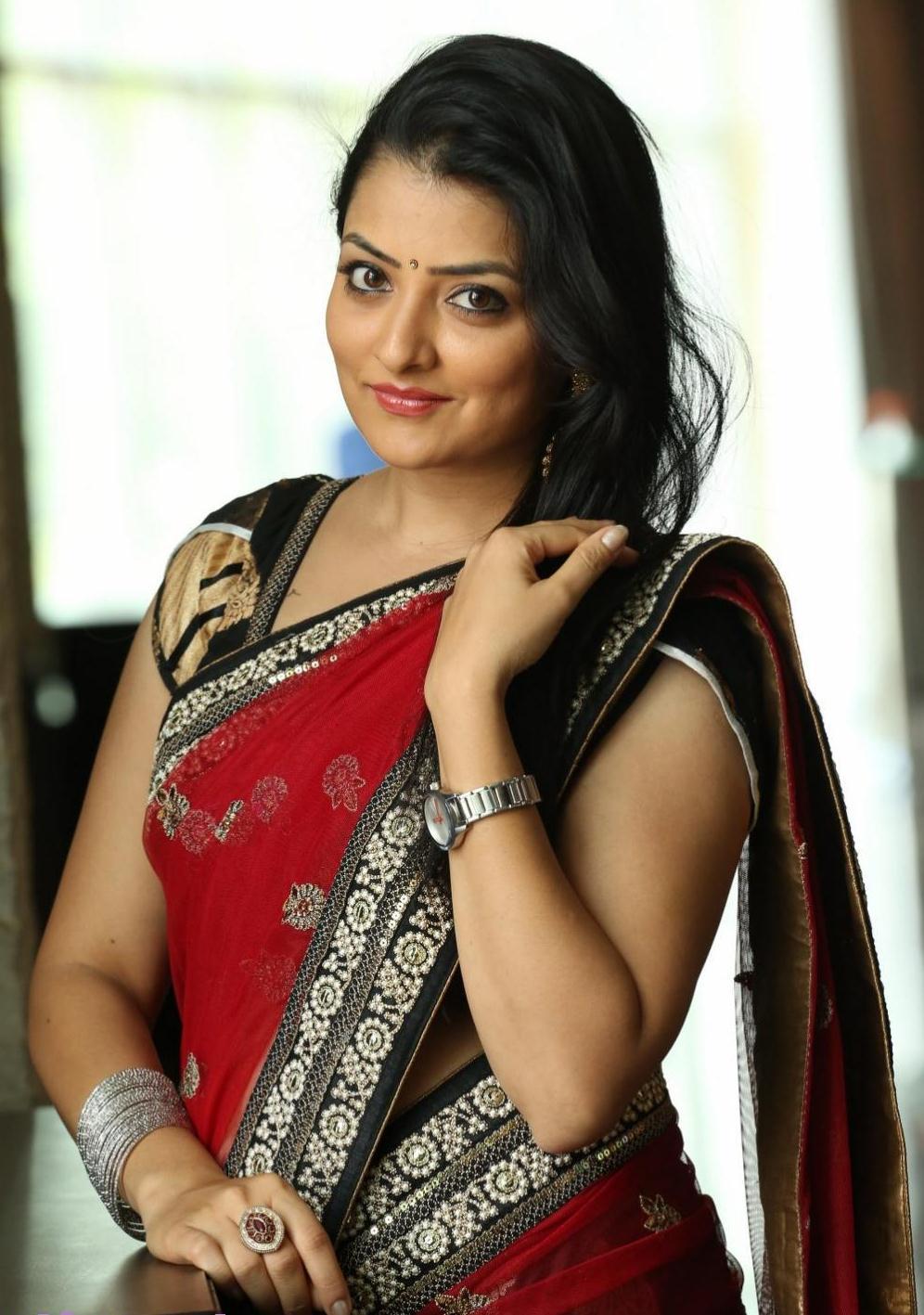 Glamorous Tv Actress Madhuri Hip Navel Stills In Transparent Red