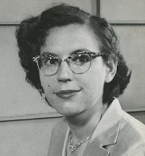 Black and white photograph of Mary Sherman Morgan from the 1950s. A woman with short hair and glasses.