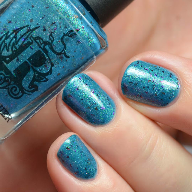 blue shimmer nail polish with flakies