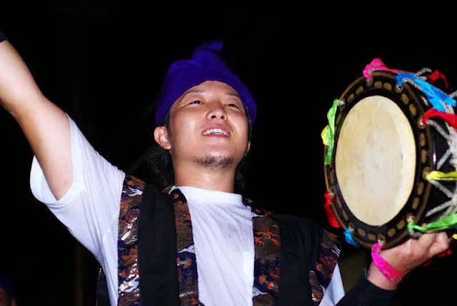 male Eisa performer with small drum
