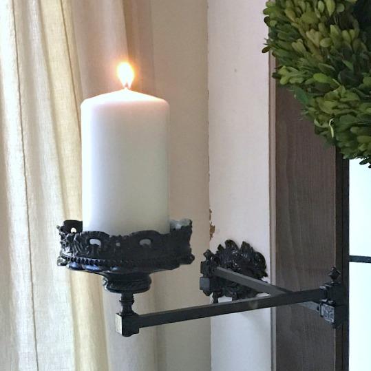 Folding arm candle holder