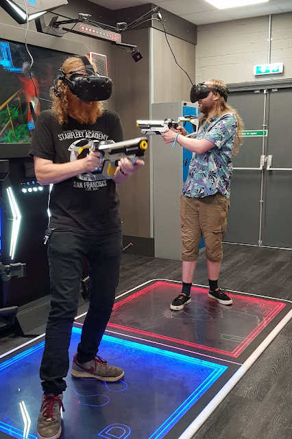 two person shooter VR gaming at X-Gen VR Stockport men standing with guns and headsets
