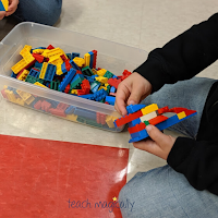 Kid building with connecting blocks Teach Magically