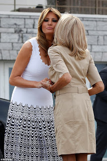 Melania Trump dons a $3,000 dress as she's greeted with a kiss on the cheek from the French first lady