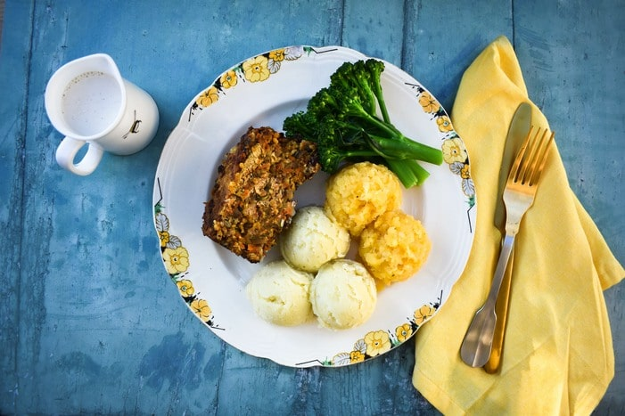 Easy vegan haggis served with tatties, neeps and a creamy whisky sauce