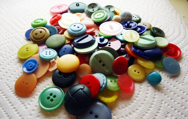 usually attached to an article of clothing or garments in  Different Types of Buttons Used in Garment