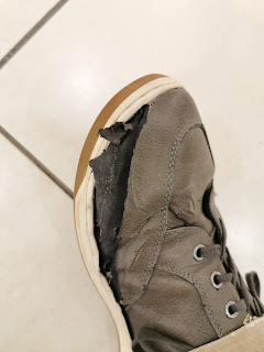 A destroyed Vostey Leather Men's Fashion shoe, ripped apart from the rigors of daily use