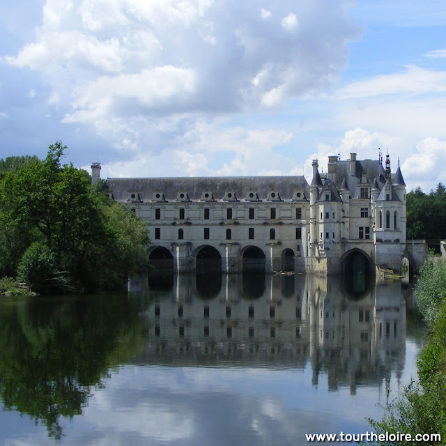 Chateau de Chenonceau reflected in the River Cher during the Covid19 restrictions.  Indre et Loire, France. Photographed by Susan Walter. Tour the Loire Valley with a classic car and a private guide.
