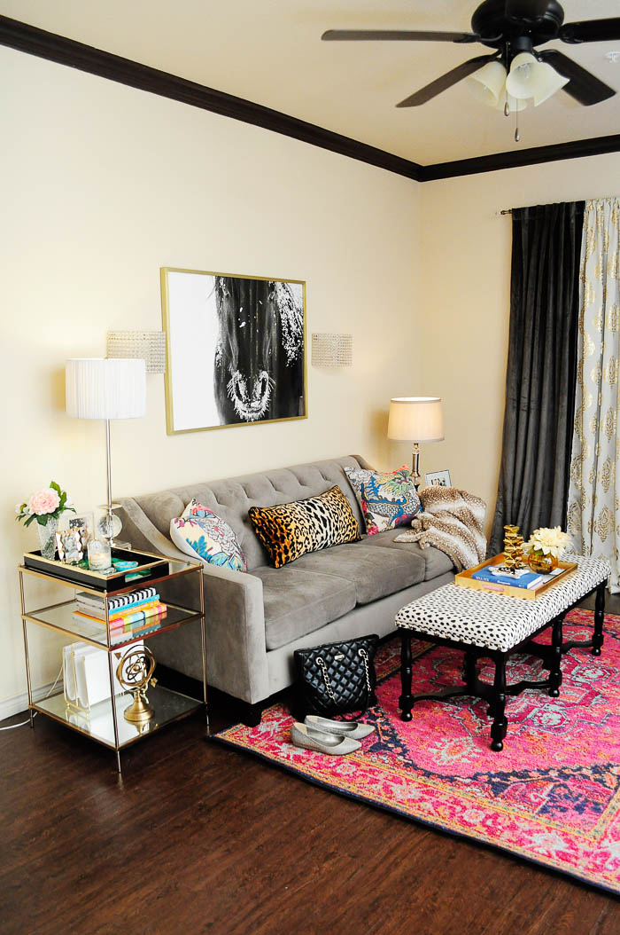 A small apartment sized sofa makes an impact in this glam, eclectic living room. | via monicawantsit.com