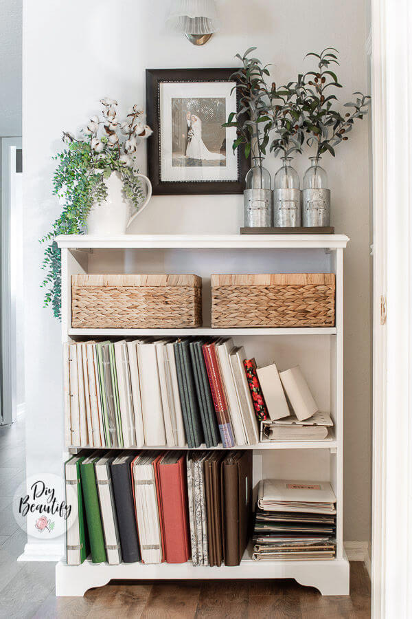 painted bookcase with fabric covered albums