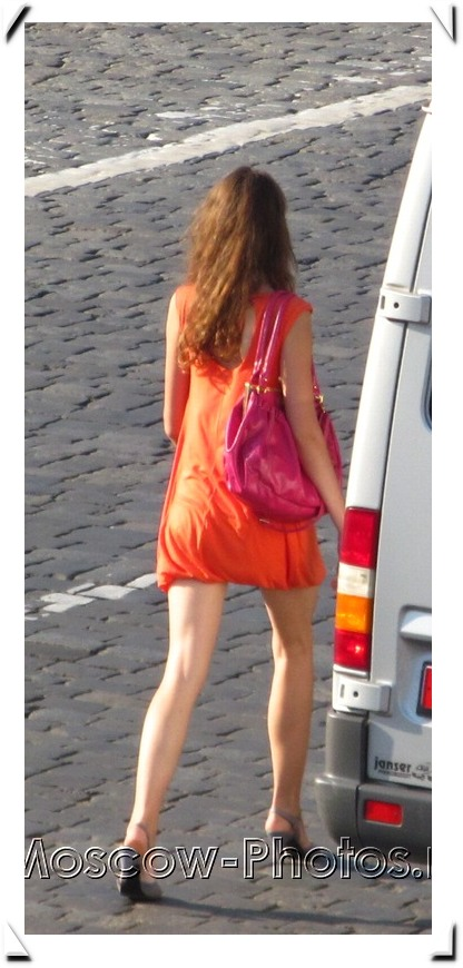 Red-head girl in red summer mini dress