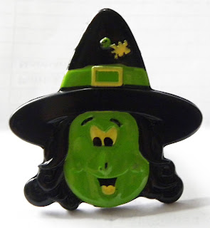 Green witch ring in plastic