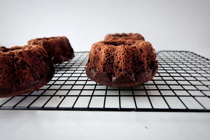 mini bundt cakes cooling on rack
