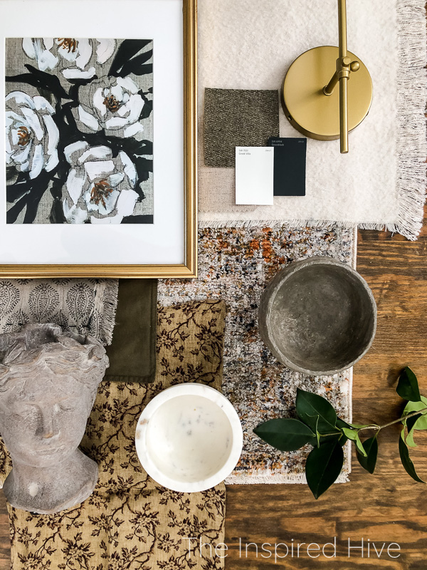 Modern traditional living room design flatlay with textures, brass, and floral art