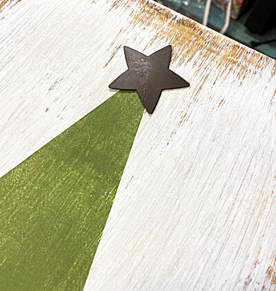 metal star on the top of the tree
