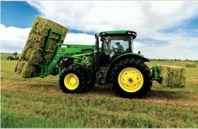 "Alt: = ""photo of farm tractor"""