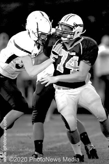 SJO lineman Logan Carr plays in 2011 football game
