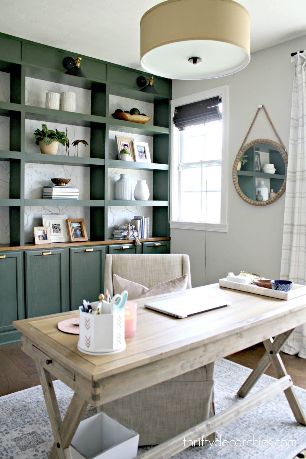 Wall of DIY bookcases in office