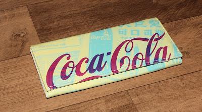 Carteira Newspaper Coca-Cola