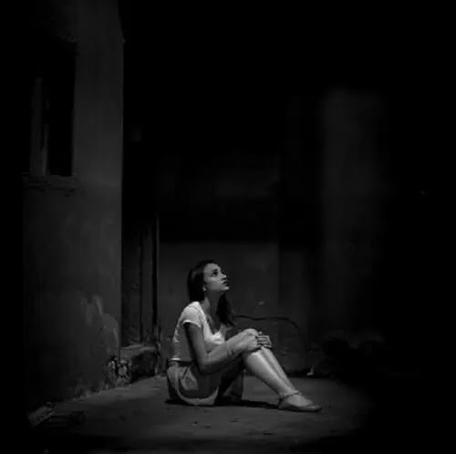 girl sitting alone at night