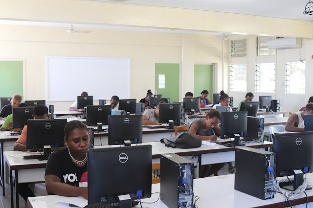 SINU Students in the computer lab . Photo by SINU