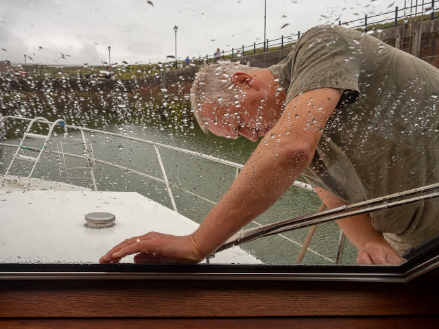 Photo of Phil cleaning around Ravensdale's windscreen