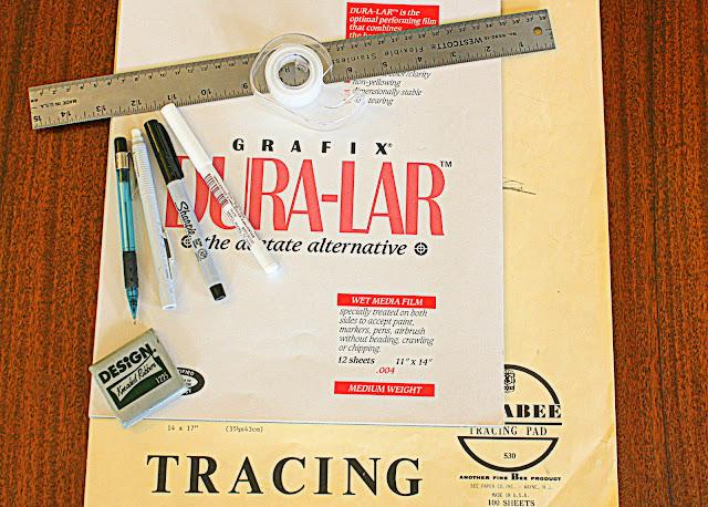art supplies, tracing paper, clear acetate, white pen, black marker, ruler, pencil, eraser, tape