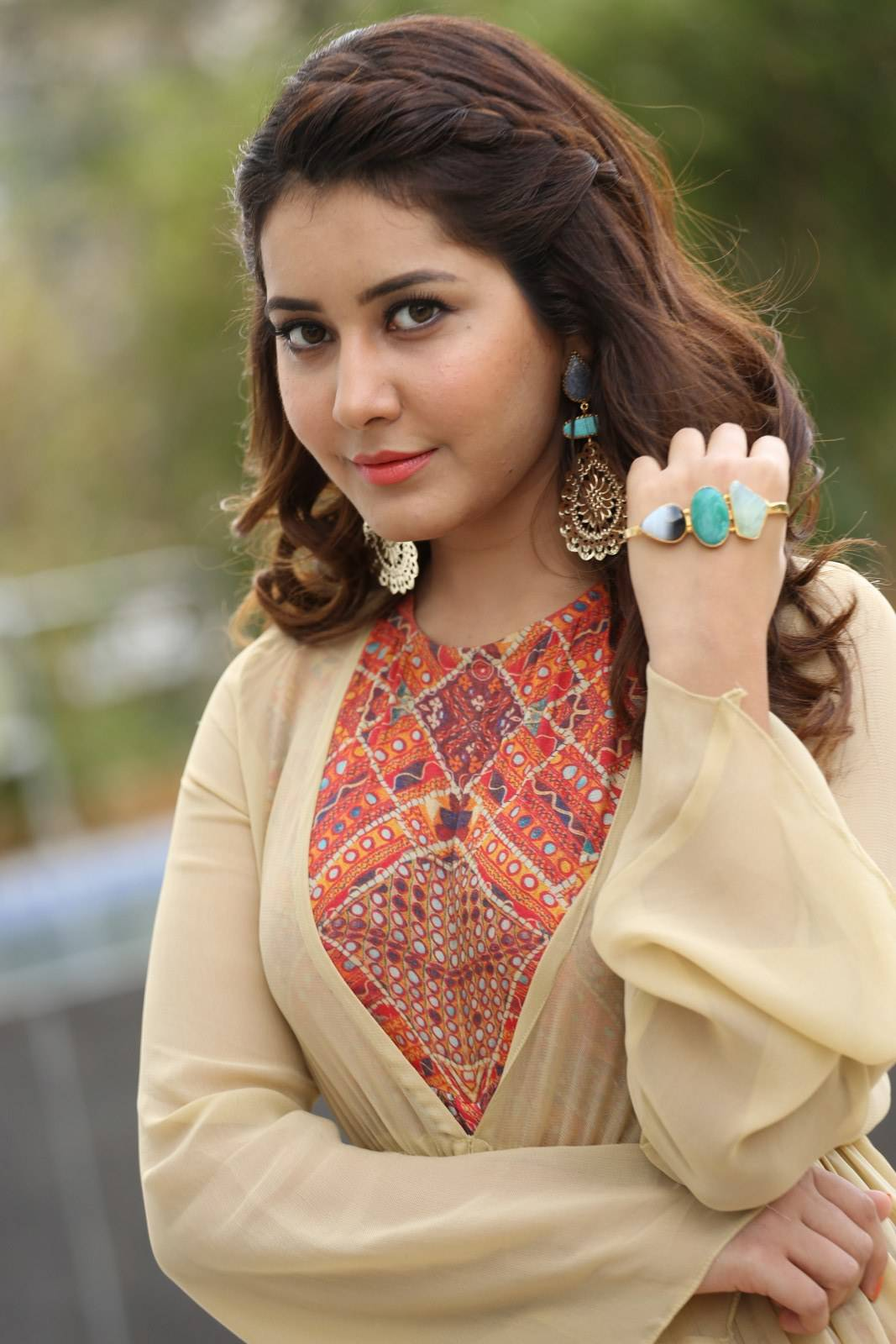Rashi Khanna Stills In Yellow Dress At Film Promotion