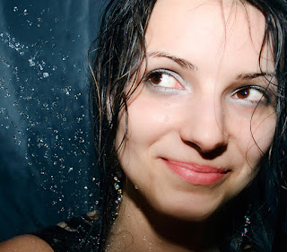 Image of a smiling woman in the shower: Showering away the swimming itch