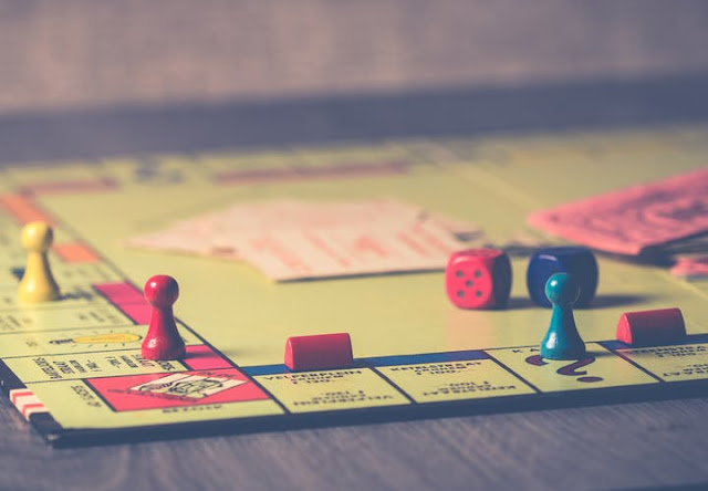 Monopoly board:Photo by Ylanite Koppens from Pexels