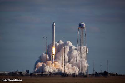 Rocket launch with billowing smoke