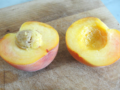 sliced peach with pit