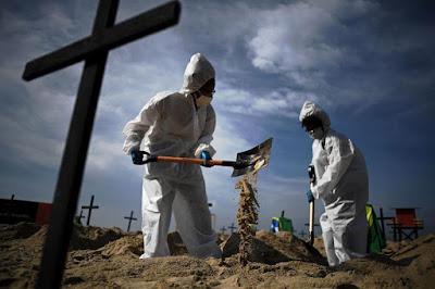 Activists from the Brazilian NGO Rio de Paz dug graves in Copacabana Thursday. AFP VIA GETTY IMAGES