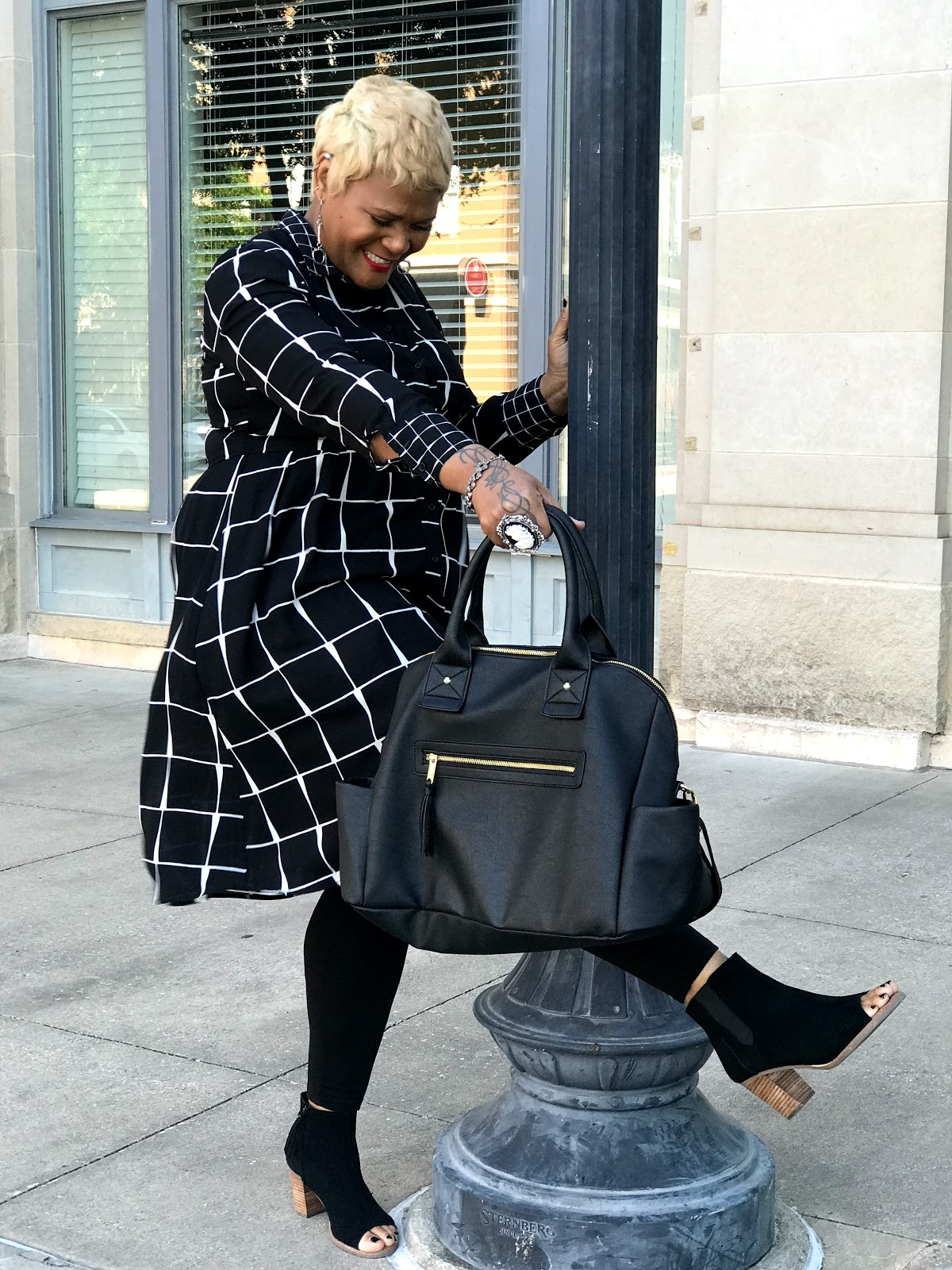 Image: Woman (Tangie Bell is sharing her Outfit Of The Day and how she styled it for Easter Sunday