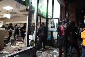 New York under curfew as looters hit city's top luxury stores