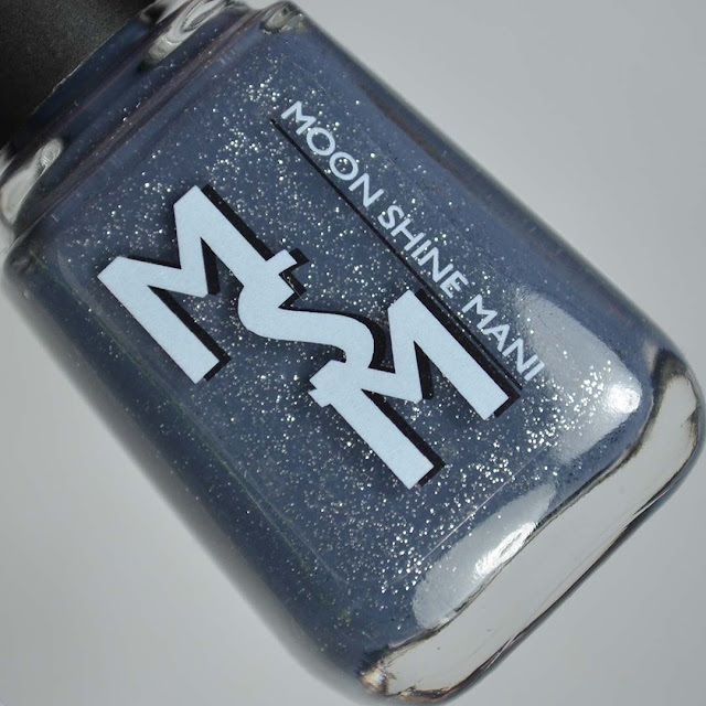 denim blue nail polish with silver glitter in a bottle