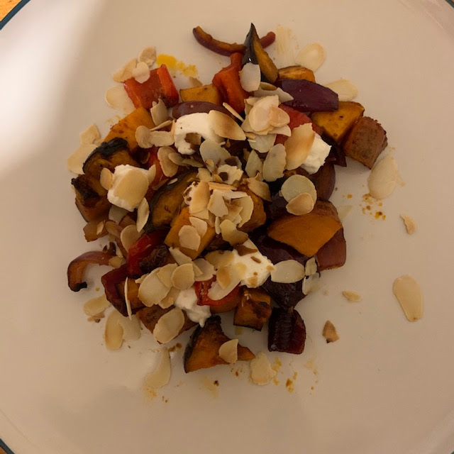 Roasted harissa vegetables with goat's cheese and almonds
