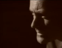 videos-musicales-de-los-90-phil-collins-another-day-in-paradise