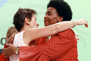 UNFCCC Executive Director Christiana Figueres hugs South African Foreign Affairs Minister Maite Nkoana-Mashabane (right) at the close of negotiations at the COP17 Climate Change Conference in Durban on December 11, 2011,
