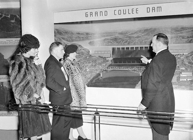 Prominent representatives of the state of Washington look at a diorama of Grand Coulee dam, part of their state's exhibit at the New York World's Fair on May 1, 1939, after opening day ceremonies on April 30. From left are Mrs. E.B. McGovern, U.S. Senator Homer Bone, Mrs. Bone, and Comm. E.B. McGovern, representing the governor.