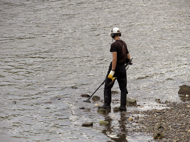 At work with a metal detector near the Battersea Bridge, London