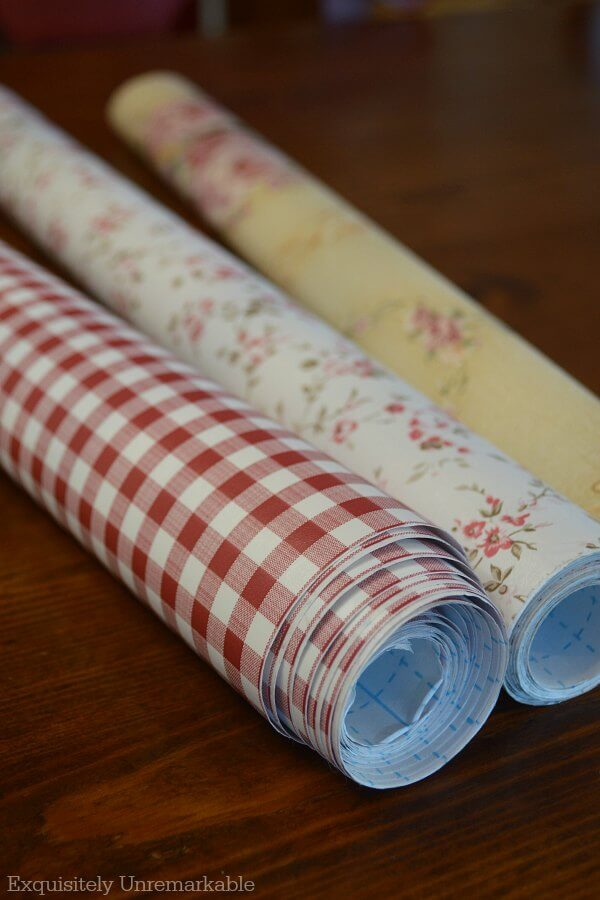 Three rolls of checked and floral contact paper