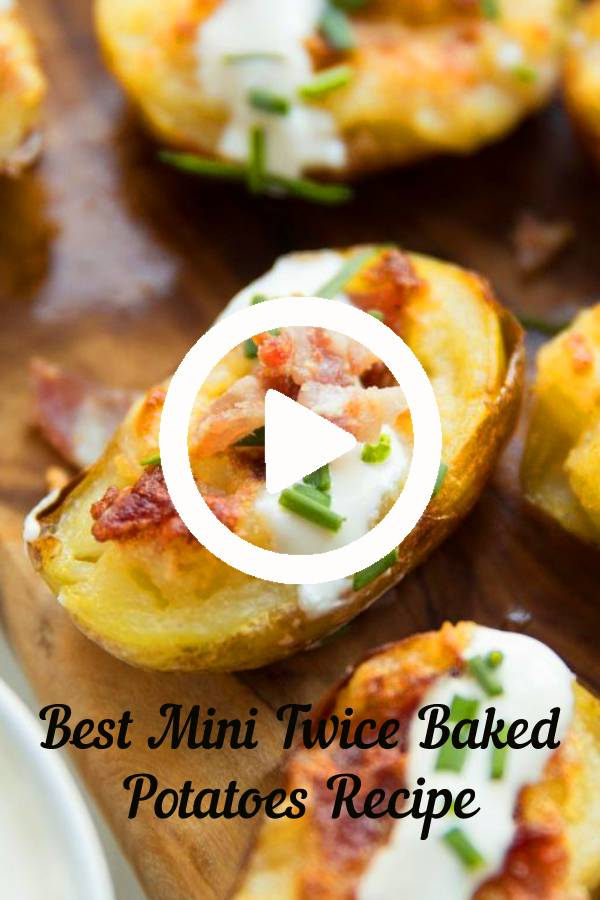 These Mini Twice Baked Potatoes are loaded with bacon and served with sour cream and fresh chives. Say hello to your new favourite finger food! #cheese #bacon #potato #loadedpotatoes