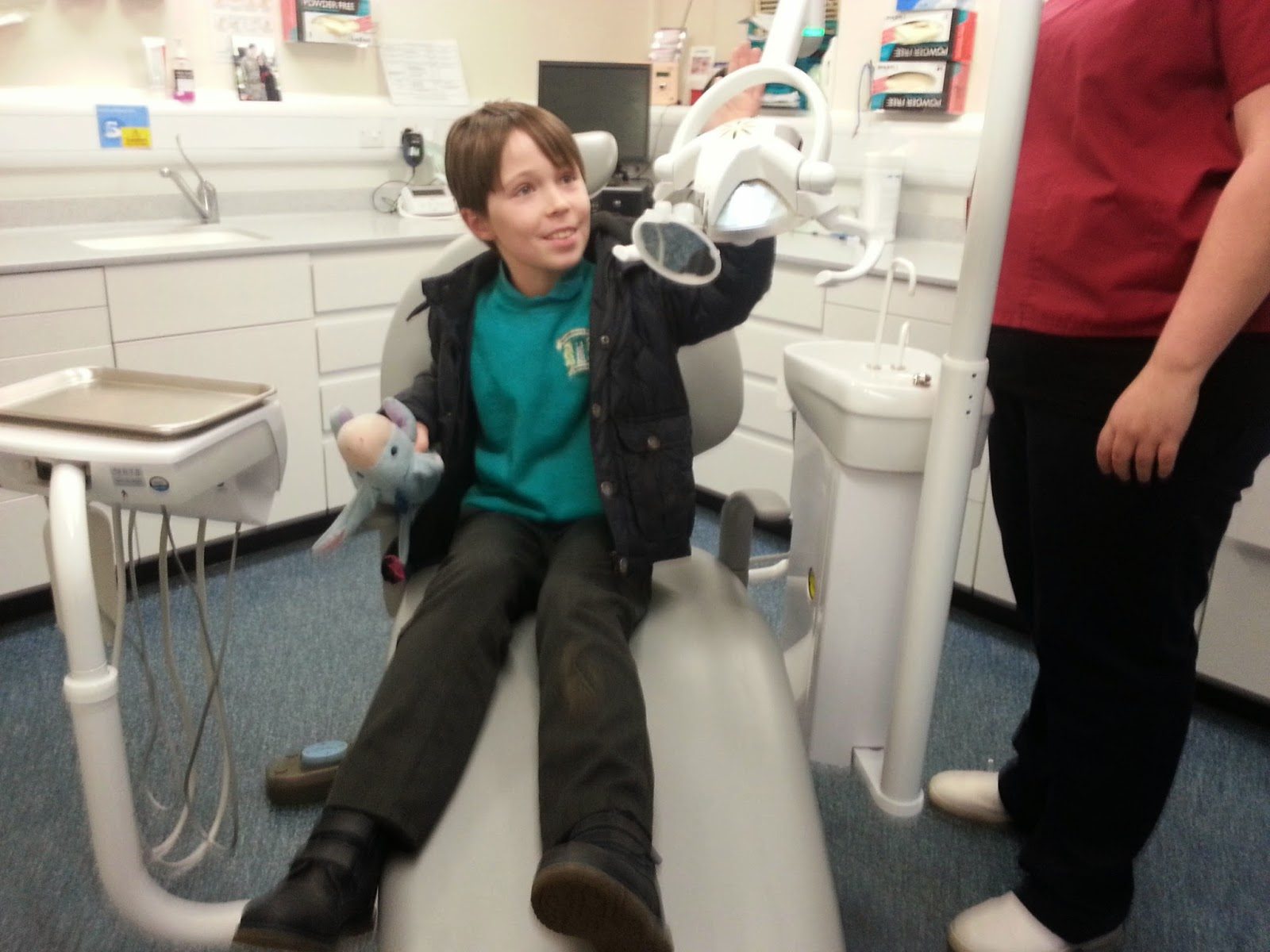 Sitting in the dentist's chair.