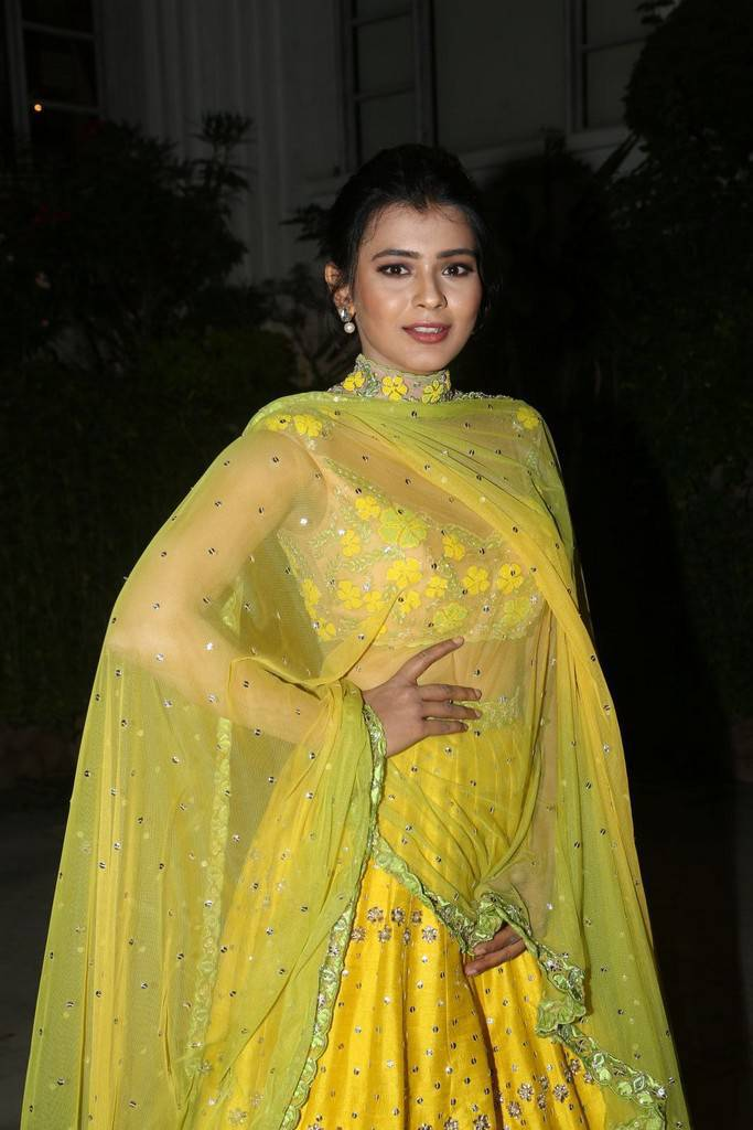 Hebah Patel Stills At Audio Success Meet In Yellow Dress