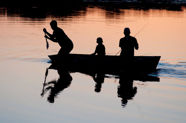 fishing at sunset, family in boat.Photo by Jed Owen on Unsplash