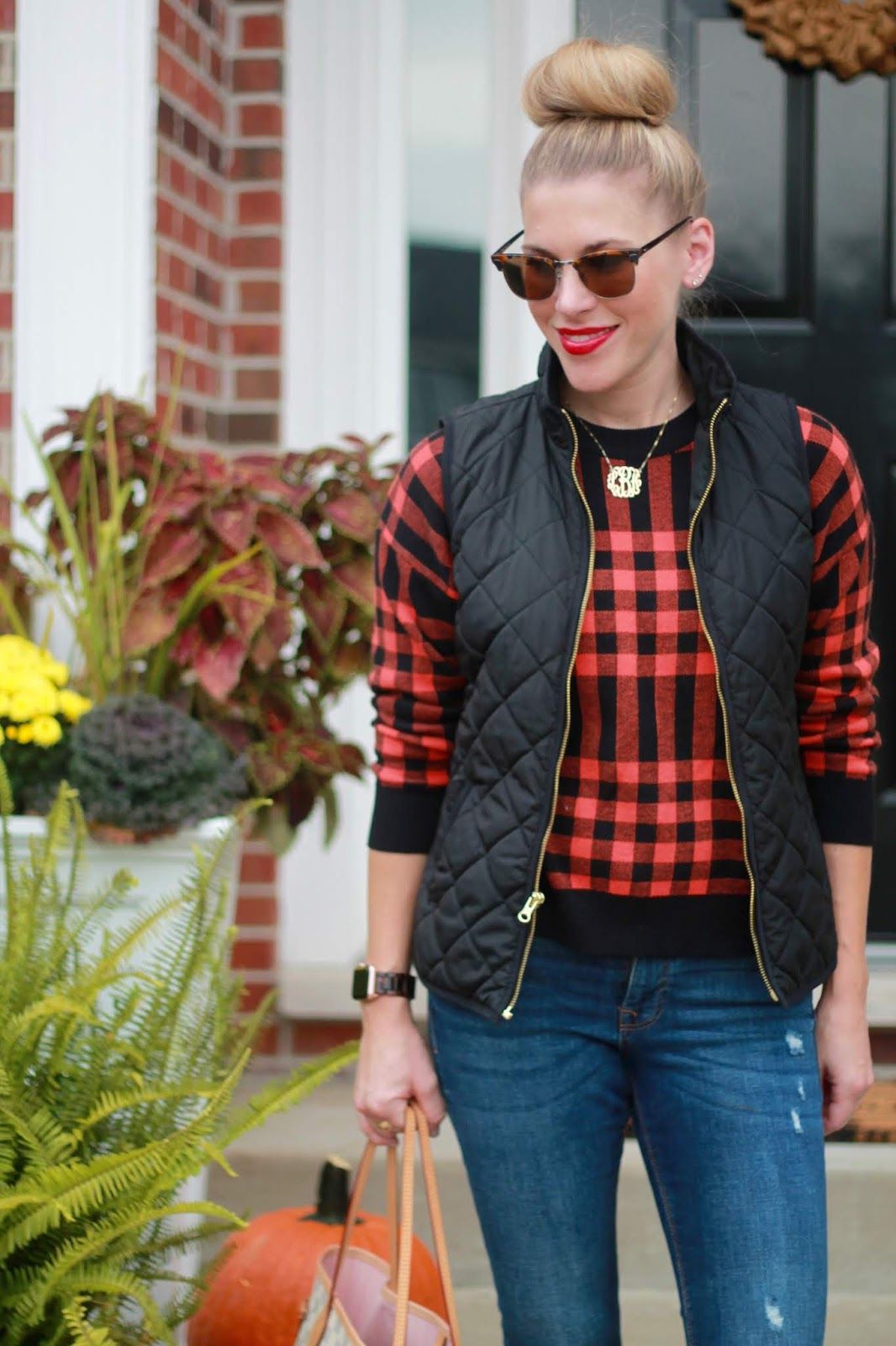 red black plaid sweater, black quilted vest, distressed jeans, LV neverfull azure, cognac loafers