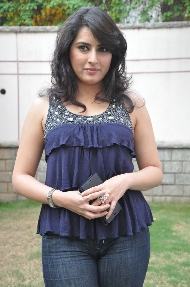 Archana in regular simple top with dark jeans looking simply stylish