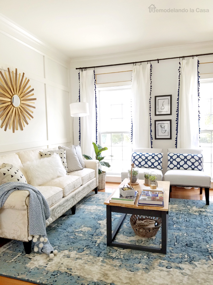 board and batten wall, farmhouse coffee table, white and blue tassels curtains
